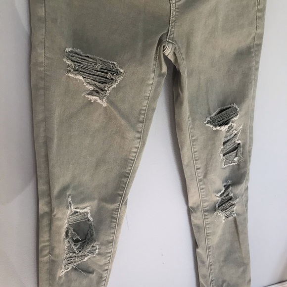 Army green ripped skinny jeans